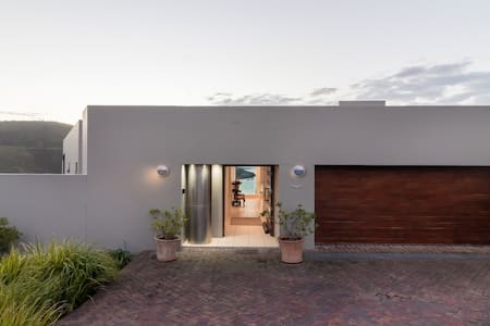 Entrance via driveway or garage to top floor with lift and staircase.