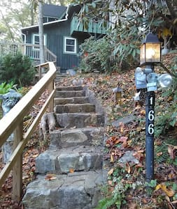 landscape lighting lights the steps from the parking area.