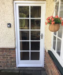 Entry door with small step over threshold.