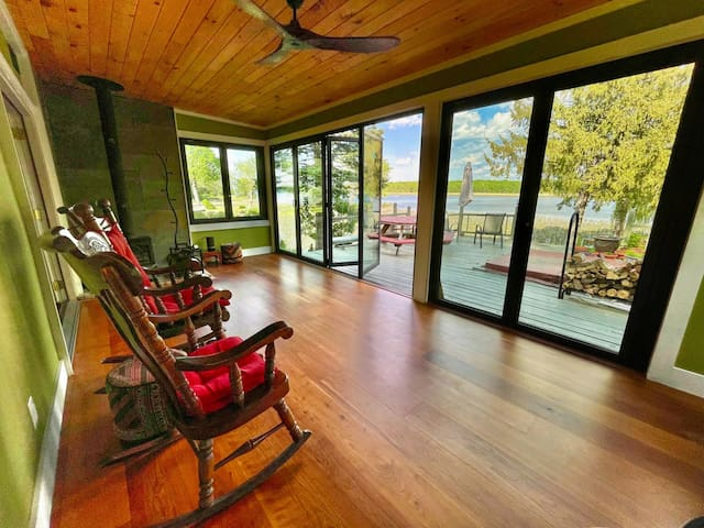 sunroom, opening onto deck and river (guests may not use the wood stove—sorry)
