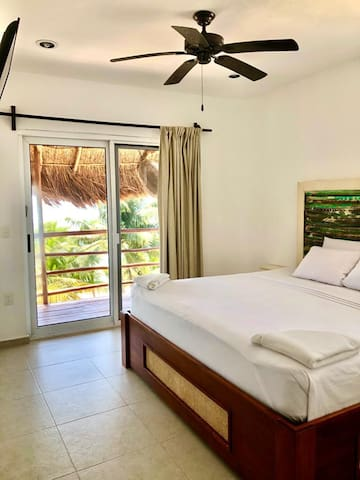 1st Bedroom with King size bed, HD TV, Closet, A/C and Balcony access
