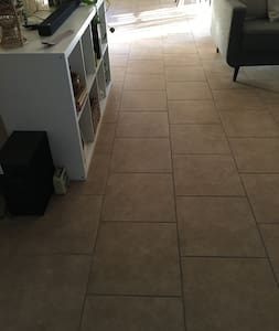 We have tile throughout the home and carpet in the bedrooms.