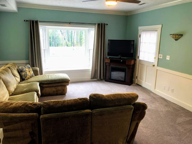 Sun room overlooks the pool; includes sectional and TV