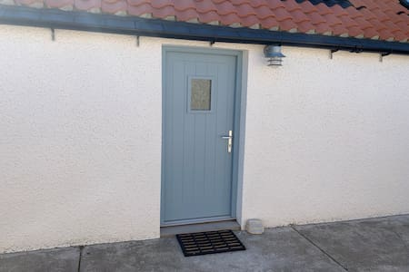 Traditional fisherman's cottage with a small narrow entrance