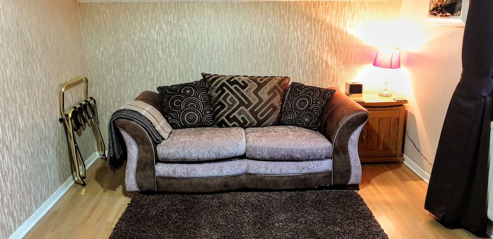 Beautiful soft sofa bed.  Once made in to a bed the width is narrower than a standard double therefor will fit 2 children or one adult.  I have  use of a single fold down bed for a second adult.