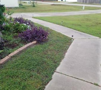 view of driveway to walkway to front door