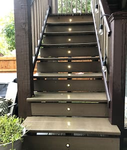 Stairs leading up to the 3rd floor Airbnb private entrance of your own whole fully-loaded 1-BR apt.