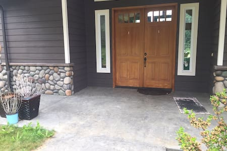 """Each of the double doors is 36"""" wide and 8' tall. There is a sloped threshold that is even with the doormat."""