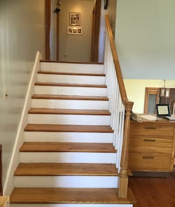 The wide stairway leads to the bedrooms and bathroom.