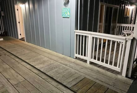This shows a lighted path to a side entrance, off the carport, on the street level.  This may be helpful to people preferring no stairs to get inside.
