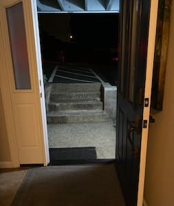 Lighted approach to the front door looking from the inside.