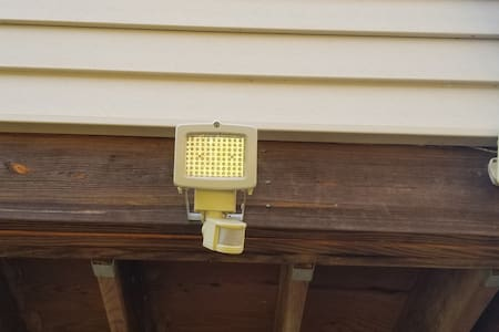 This light turns on right before you enter the covered porch, located right outside of the guest suite.