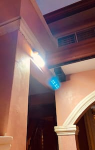 There is a sensor light above the main gate entrance that automatically lit when it sense movement around it during night time.