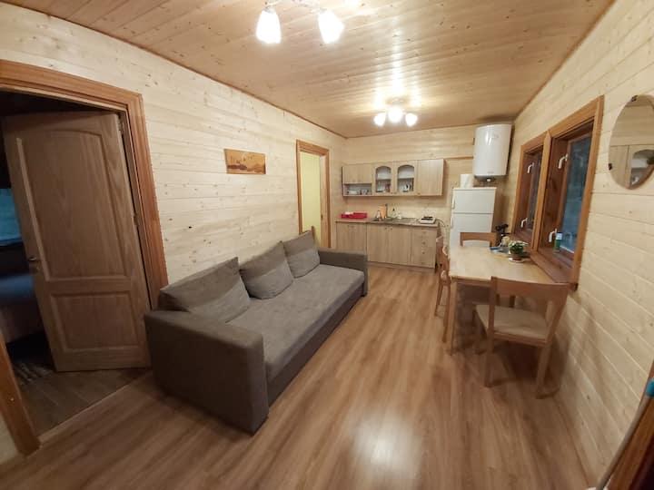 Cozy cabin by the sea, near city.