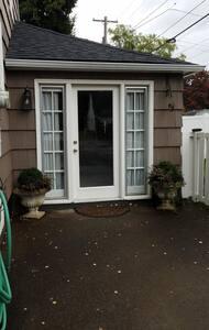 Front door to cottage room, sensor light
