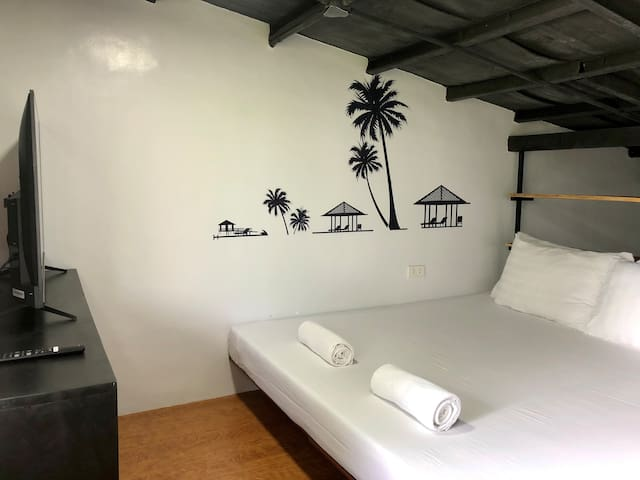 King-size bed on the second floor, with a Smart TV. Guests are also provided access to free Wi-Fi and Netflix.