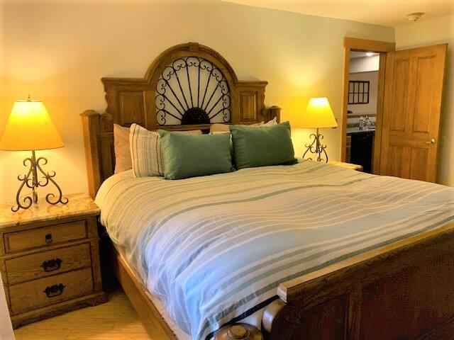 Oversized master bedroom with king bed, private bathroom and views of  Howelsen Hill Ski Area