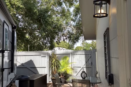 All exterior lighting will automatically come on at dusk and off at dawn.  There is a light on the private patio adjacent to the RV entrance. Additionally, there are lights illuminating the parking and entrance to the private patio.