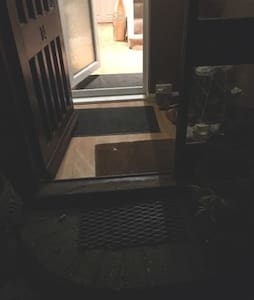 This the entrance to the house, 2 steps up from the ground, another step once in the porch