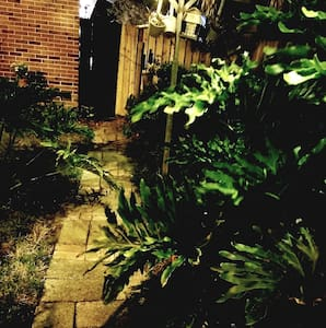 The flood light itself lights this pathway, but there are additional lights our GUESTS can plug in to enhance the mood.