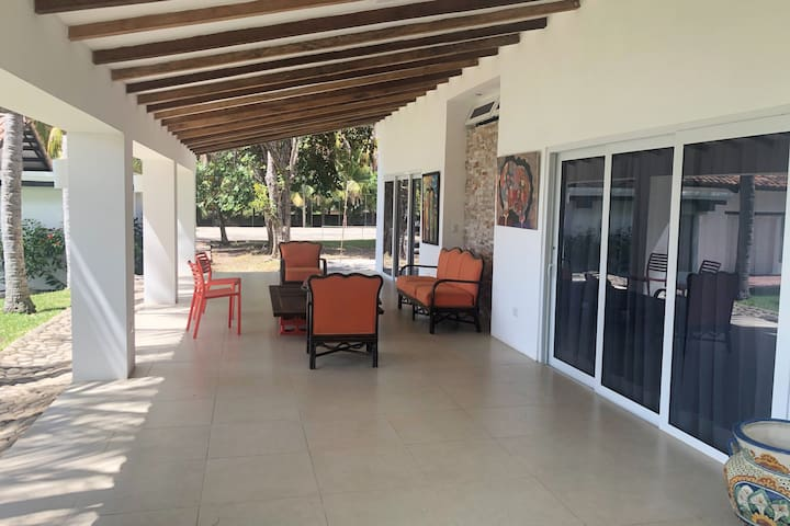 Bungalow, two rooms with attached  full bathroom, and front terrace. Rooms are 300 square feet.