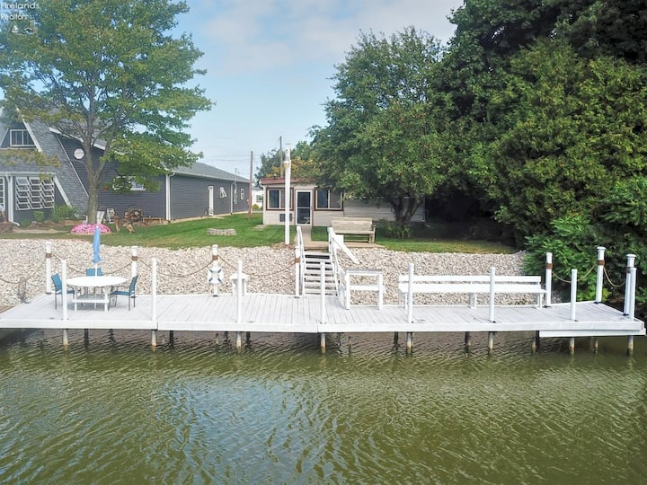 Relax on the boat dock located in the back yard!