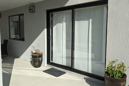 The entrance lockable sliding doors. Nice and sunny Alfresco area to enjoy day/night  and plenty of lights around the place at night i.e sensor and switch lights.