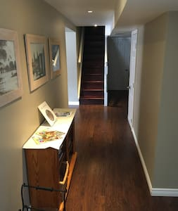 """Hallway leading to bedrooms, bathroom, living room, dining area, and kitchen. Width from shelf to wall is 100 cm (39"""")"""
