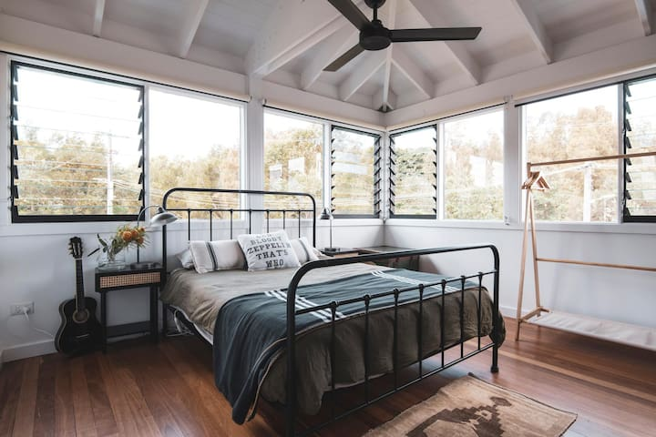 One of the two upstairs bright and airy queen bedrooms.