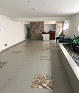 Lobby entrance, behind the white wall is the elevator to the apartment