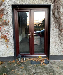 Small step and ledge on door.