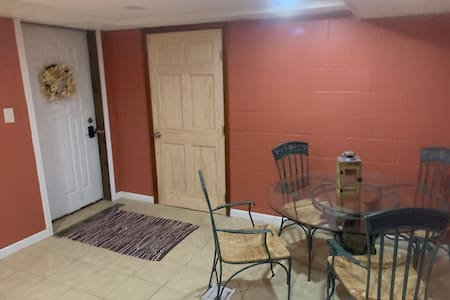 """36"""" outside white door to the front of the house."""