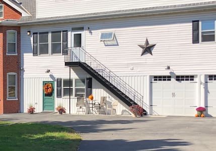 Guests park right beside our farmhouse, access the apartment via our well lit paved driveway, well lit stairs with railing, and through the well lit hallway inside.