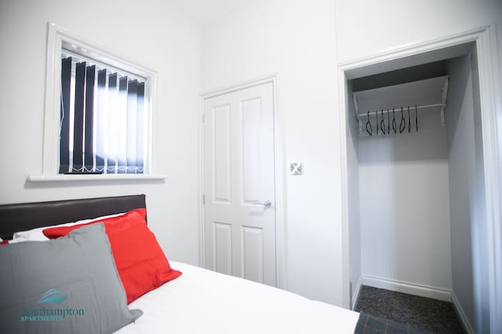 The bedroom is fitted with a large double bed and flat-screen TV. Hotel-grade linen, pillows and towels are provided for your comfort