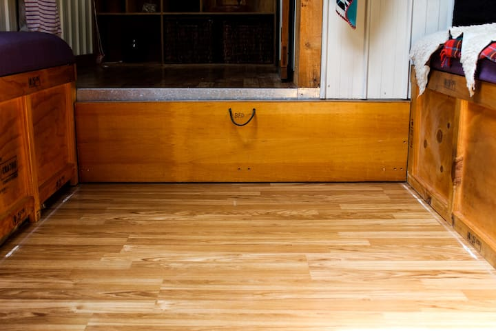 The bed pulls out from the landing area. Please watch your toes when you pull it out!