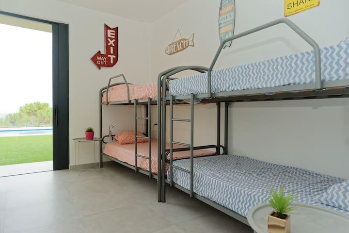 Bedroom5 with 4 single beds, bottom floor level