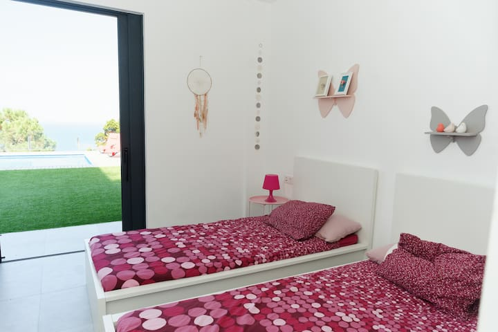Bedroom3 with 2 single beds (that can become a double bed),  bottom floor level