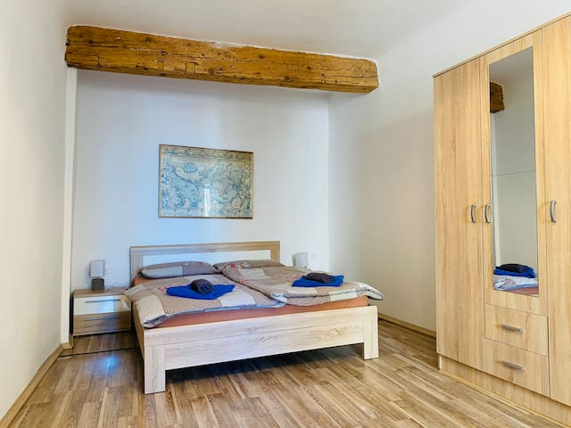 Seaview bedroom features original wooden beams, stone wall and brand new quality mattress