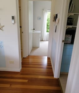 Entry into bathroom and second bedroom
