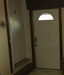 Door with window light is the entrance door to the home which accessed the workout room. Door to the left is the door to the main house.