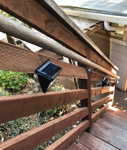 There are solar powered motion lights that turn on as you walk down the stairs for lighting at night.