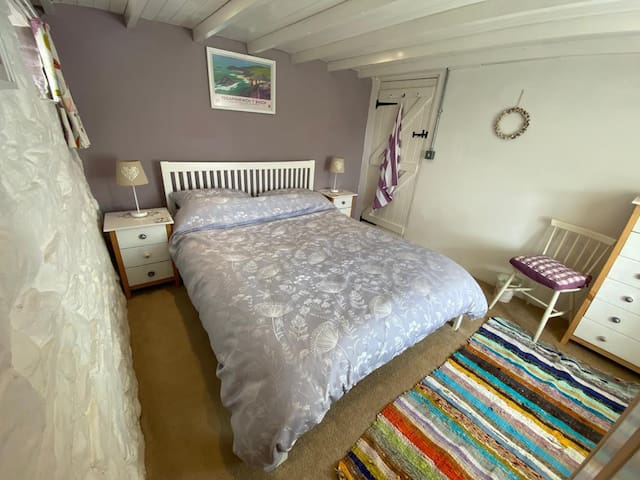 Downstairs double with King size bed.   If you want a cot,  we can put one in here.  We  can remove the bedside table to the hallway so it will give you a bit of extra room.