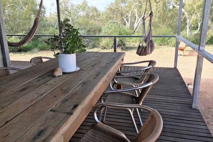 The Hale Hutt is a delightful 3 bedroom cottage nested in the privacy of the Australian bush!  Raised on stilts with a sweeping deck, it is the perfect spot to relax with a wine and your binoculars for some bird spotting!