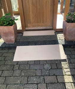 To gain step free access to the front door there are ramps that can be added at a moments notice.