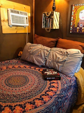 """My comfy bed everyone loves. I put for your enjoyment """"Death at the Dive Bar"""" mystery game. If you ever need extra blankets or pillows just let me know."""