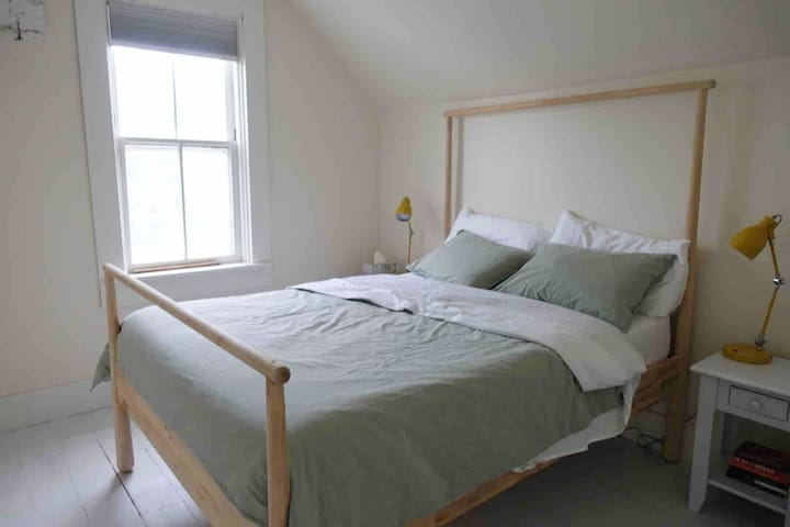 The bedroom features an incredibly comfortable and supportive Queen mattress. All pillows and linens are feather-free.