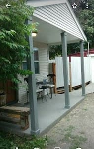 entrance on side and most accessed, easy pull up driveway and access house.
