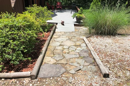 "Path to front door is more than 32"" wide; rock portion is a bit uneven and slight slope where deck begins."