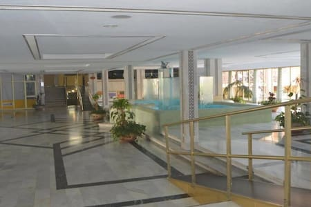 Lobby entrance with ramp (building exterior also has ramp)