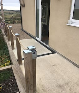 Flat, concrete entrance to property with low door threshold.